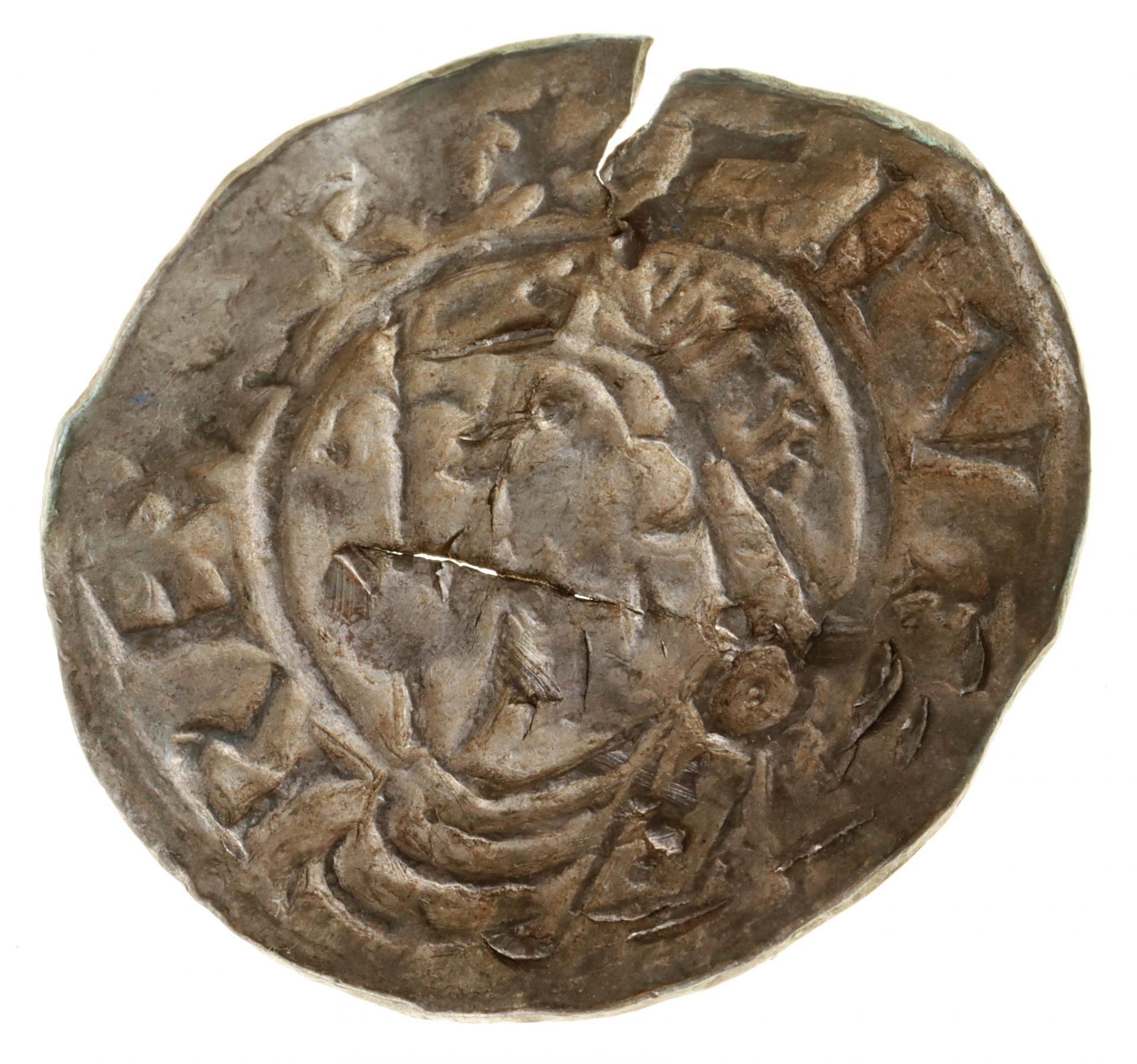 Ett svenskt mynt, med ett jack i kanten.