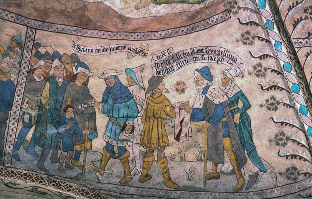 Medeltida målning som föreställer människor som handlar med textilvaror