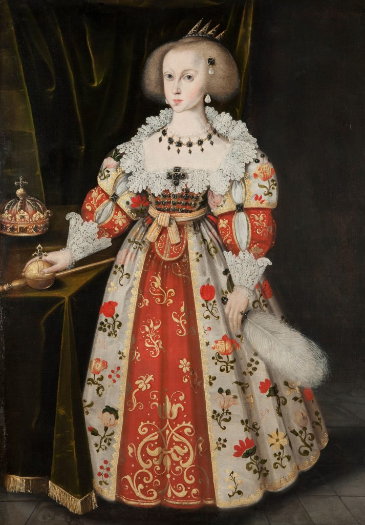 Porträtt av en ung flicka i färggrann klänning.