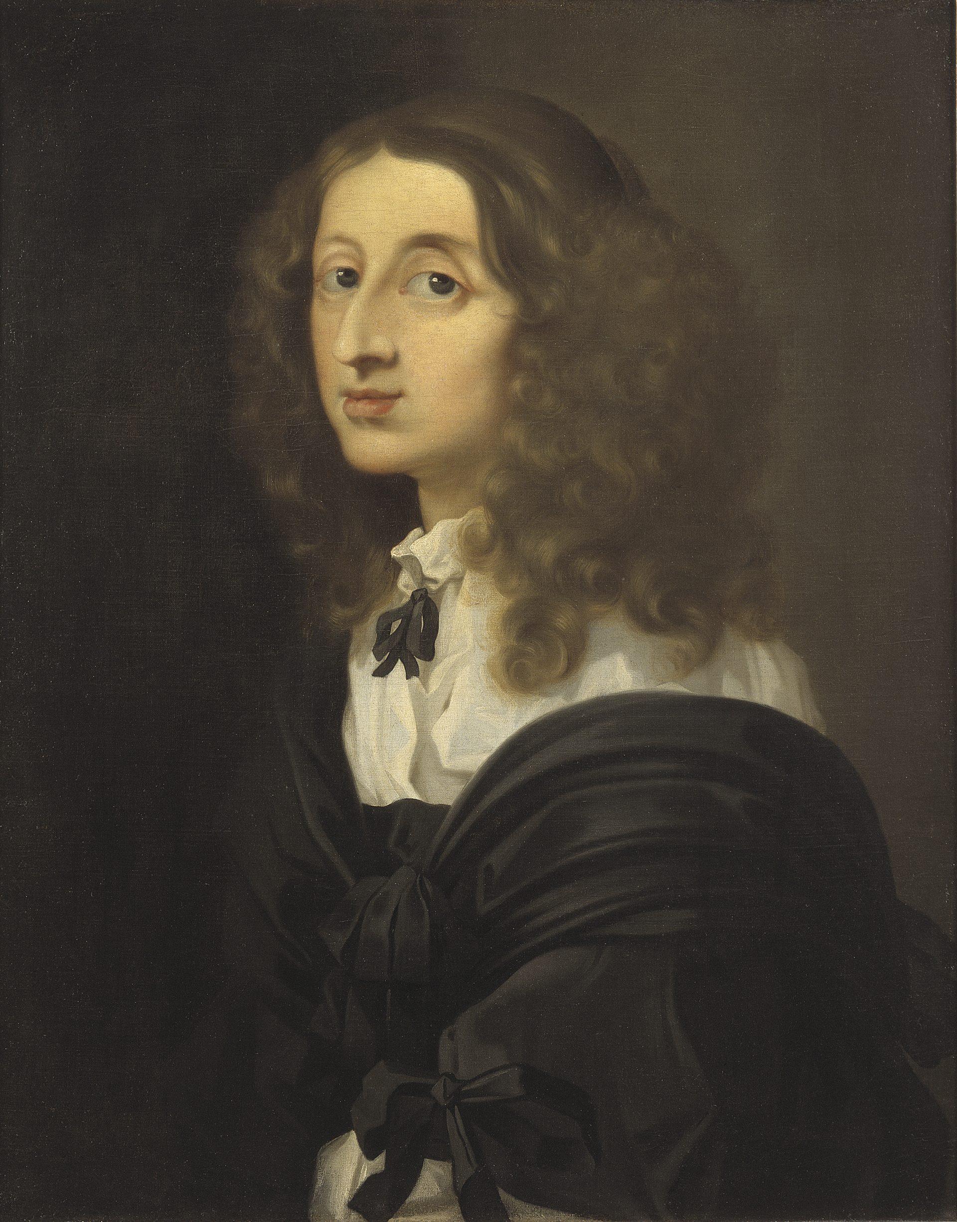 Ett porträtt av en kvinna med långt hår, svart dräkt och vit krage