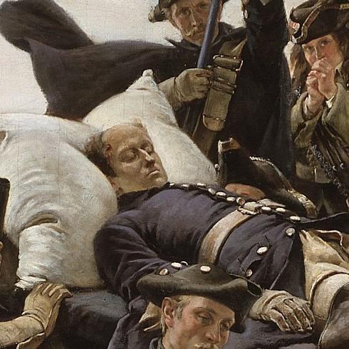En död man på en bår.