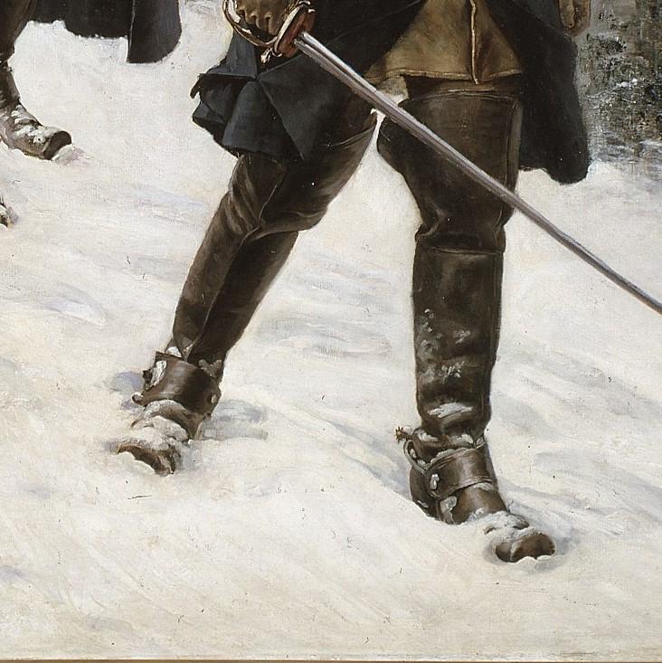 En man som går i snön.