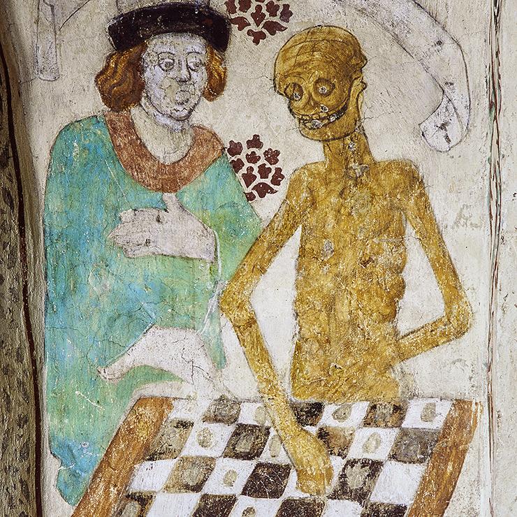 Kyrkmålning som föreställer en man som spelar schack med ett skelett.